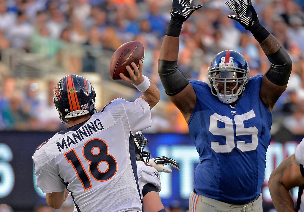 . New York Giants\' Shaun Rodgers (95) attempts to block a pass by Denver Broncos quarterback Peyton Manning (18) during the second quarter September 15, 2013 MetLife Stadium. (Photo by John Leyba/The Denver Post)