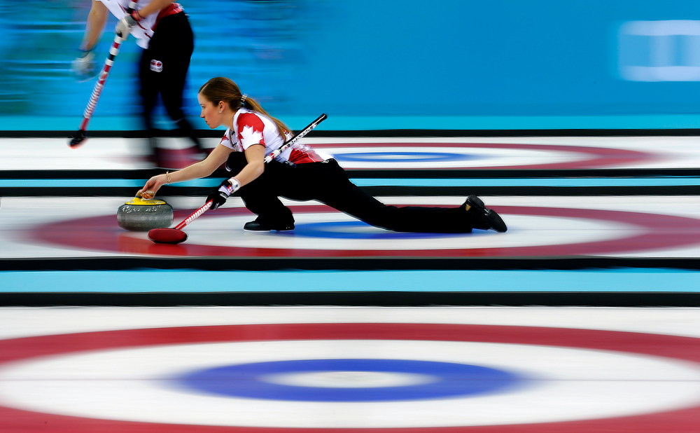 . Canada\'s Kaitlyn Lawes delivers the rock during the women\'s curling gold medal game against Sweden at the 2014 Winter Olympics, Thursday, Feb. 20, 2014, in Sochi, Russia. (AP Photo/Wong Maye-E)