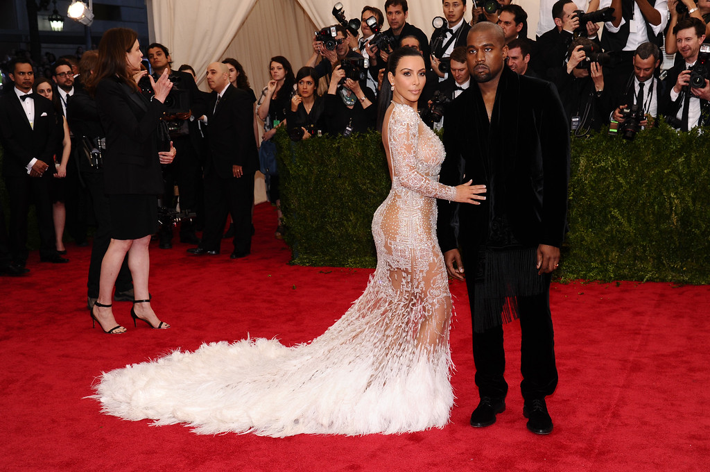 """. Kim Kardashian, left, and Kanye West arrive at The Metropolitan Museum of Art\'s Costume Institute benefit gala celebrating \""""China: Through the Looking Glass\"""" on Monday, May 4, 2015, in New York. (Photo by Charles Sykes/Invision/AP)"""