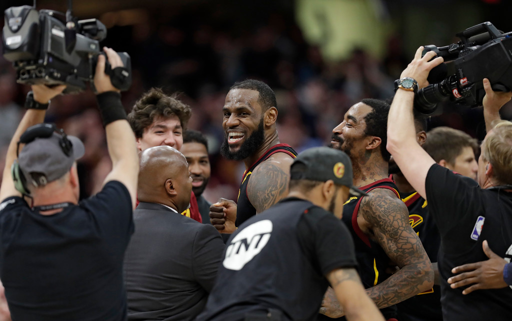 . Cleveland Cavaliers\' LeBron James celebrates with teammates after the Cavaliers defeated the Indiana Pacers 98-95 in Game 5 of an NBA basketball first-round playoff series, Wednesday, April 25, 2018, in Cleveland. (AP Photo/Tony Dejak)