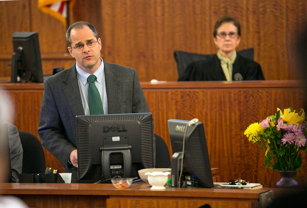 . Clerk Mark Ferriera , left, polls the jury on the verdict for former New England Patriots football player Aaron Hernandez during Hernandez\'s murder trial at Bristol County Superior Court, Wednesday, April 15, 2015, in Fall River, Mass.  Hernandez was found guilty of first-degree murder in the shooting death of Odin Lloyd in June 2013.  He faces a mandatory sentence of life in prison without parole. (Dominick Reuter/Pool Photo via AP)