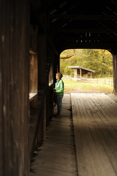 Grandma Cheryl in covered bridge at old Grafton Village Cheese Co. grounds.