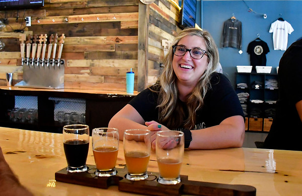 7/27/2019 Mike Orazzi | Staff Alison Mahony talks with customers at Better Half Brewing in downtown Bristol on Saturday.