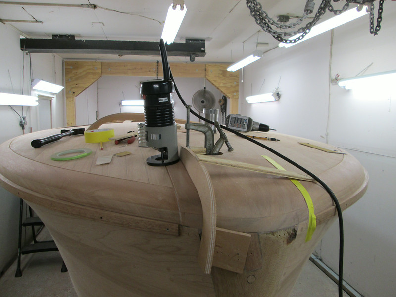 Fabricated front deck router jig with the seam routed.
