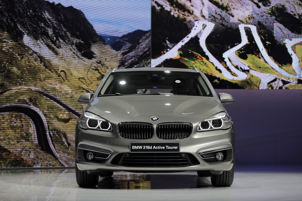 . The new BMW 218d Active Tourer is seen during a press conference as part of the media day of the 84th Geneva International Motor Show, Switzerland, Tuesday, March 4, 2014. The Motor Show will open its gates to the public from March 6 to 16. (AP Photo/Laurent Cipriani)