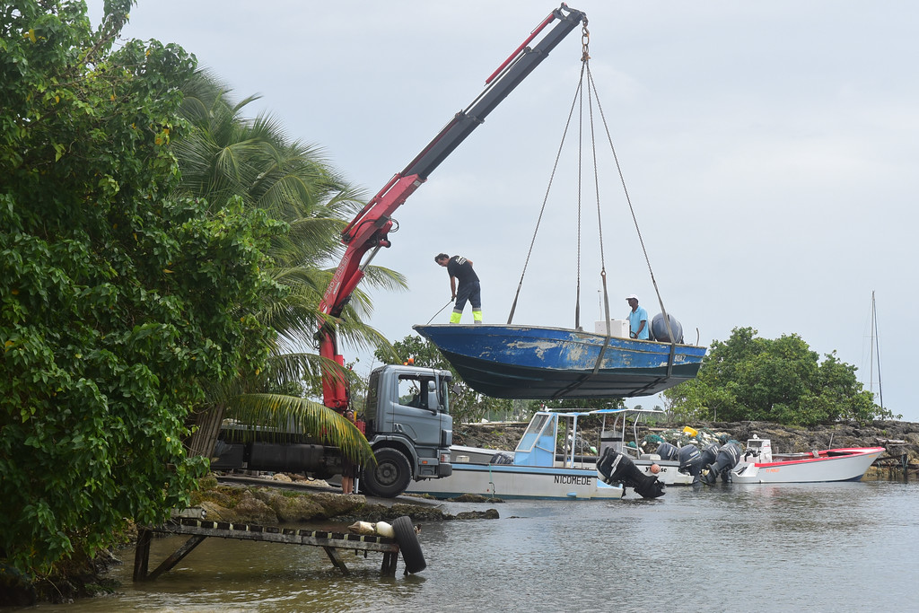 . Men remove boats from the water ahead of Hurricane Maria in the Galbas area of Sainte-Anne on the French Caribbean island of Guadeloupe, early Monday, Sept. 18, 2017. Hurricane Maria grew into a Category 3 storm on Monday as it barreled toward a potentially devastating collision with islands in the eastern Caribbean. (AP Photo/Dominique Chomereau-Lamotte)