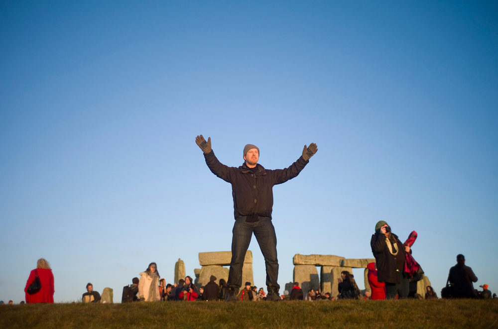 Description of . A reveller chants incantations as the sun rises during the winter solstice at Stonehenge on Salisbury Plain in southern England December 21, 2012. The winter solstice is the shortest day of the year, and the longest night of the year. REUTERS/Kieran Doherty