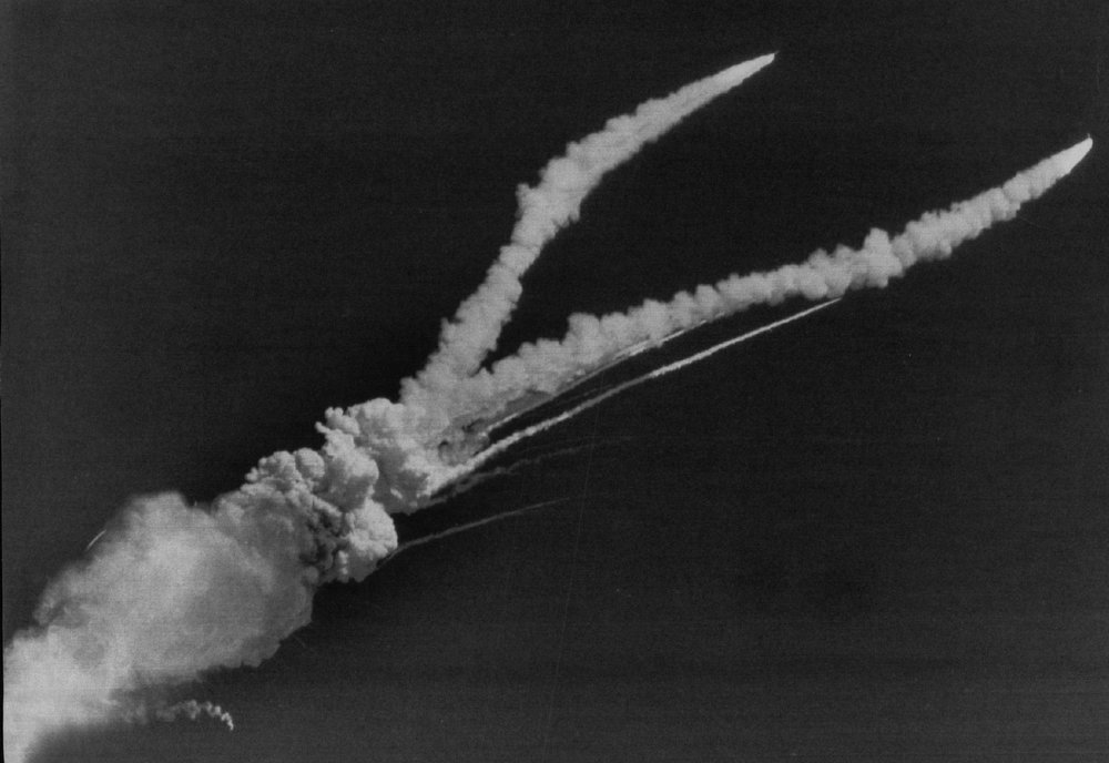Description of . A giant fire ball engulfs the Space Shuttle Challenger on Jan. 28, 1986 as the two solid rocket boosters continue their flight high above Cape Canaveral, killing the crew of seven. Denver Post Library Archive