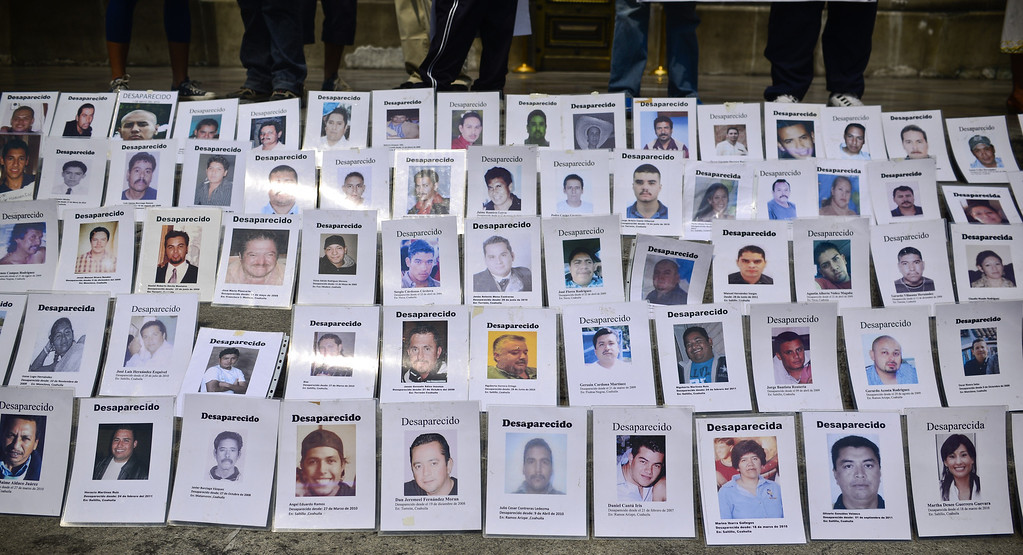 . Portraits of missing people are displayed in Mexico City, on May 10, 2013. A group of mothers and relatives are demanding that the government investigate the disappearance of their children, which they say have gone missing due to the drug war that the government started in 2006. Ronaldo Schemidt/AFP/Getty Images