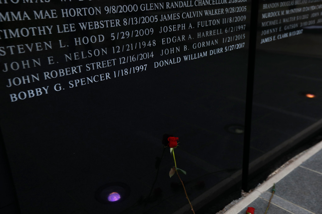. The names of three fallen lawmen were added to the Statewide Fallen Officers Memorial in Jackson, Miss., during the Mississippi Law Enforcement Memorial Candlelight Vigil, Tuesday, May 15, 2018. They are Shannon Police Chief Bobby Spencer, who was murdered Jan. 18, 1997; Lincoln County Sheriff\'s Office Deputy William Durr, who was murdered May 27, 2017, and Quitman County Sheriff\'s Office Deputy James Clark, who was killed responding to a shooting call Aug. 13, 2017. (AP Photo/Rogelio V. Solis)