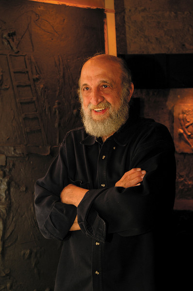 "Pappas, Detroit Artist, with his work behind him. Photoshoot for ""Body of Work"" book by Blue Cross Blue Shield of Michigan."