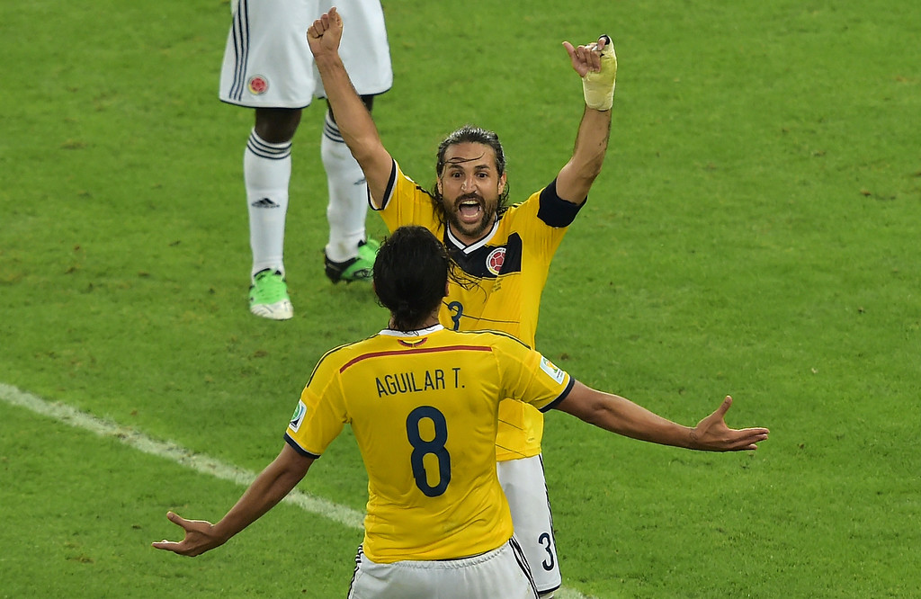 . Colombia\'s players celebrate after the Round of 16 football match between Colombia and Uruguay at the Maracana Stadium in Rio de Janeiro during the 2014 FIFA World Cup in Brazil on June 28, 2014. GABRIEL BOUYS/AFP/Getty Images