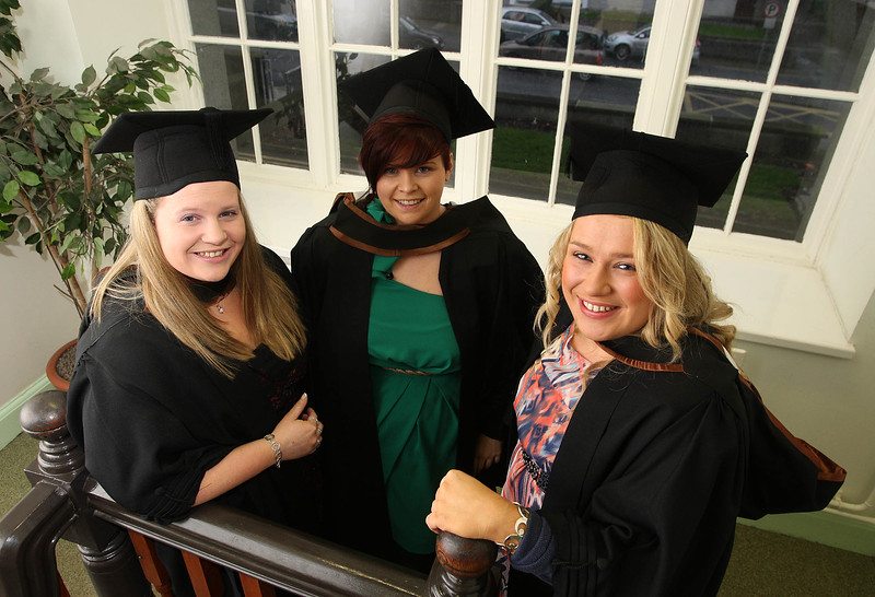 """4/1/2012. News. Waterford Institute of Technology (WIT), conferring ceremony. From Left, Laura McDermot Castlecomer, Co. Kilkenny, Natasha Maher, Goresbridge, Co Kilkenny and Anne Marie Tarrant, Cork all who graduated in Bachelor of Arts (Honors) in Marketing. Photo Patrick Browne  Upbeat mood at WIT's conferring ceremonies  An optimistic note has been signaled by Mr Tony McFeely, Acting President of Waterford Institute of Technology (WIT), at the first of 11 conferring ceremonies across three days during which 2,652 students were conferred with academic degrees up to doctorate level.  In his conferring address, Mr McFeely said: """"We cannot ignore the dark economic clouds that have surrounded the country for the past few years. Job opportunities are not as readily available as they once were. However, your academic achievements should instill a sense of self-confidence. I would encourage you to remain positive and optimistic despite the general gloom. These times will pass; they always do.""""  """"We Irish are a resilient people; you are the potential leaders of the future so it's incumbent on you to remain strong and positive,"""" continued Mr McFeely. He urged today's graduates to remember the words of Apple founder Steve Jobs at a Stanford graduation in 2005: """"Your time is limited, so don't waste it living someone else's life. Don't be trapped by dogma, which is living with the results of other people's thinking. Don't let the noise of others' opinions drown out your own inner voice. And most important, have the courage to follow your heart and intuition.""""  WIT's Chairman, Dr Donie Ormonde, continued the positive theme in his remarks: """"In the modern economy skills and competencies are the tradable commodities that enhance your life experiences and enhance the creative edge of economic and social development. Ireland's capacity to bounce back is directly related to the education and skills infrastructure that it has built. Ireland is an international leader in educational """