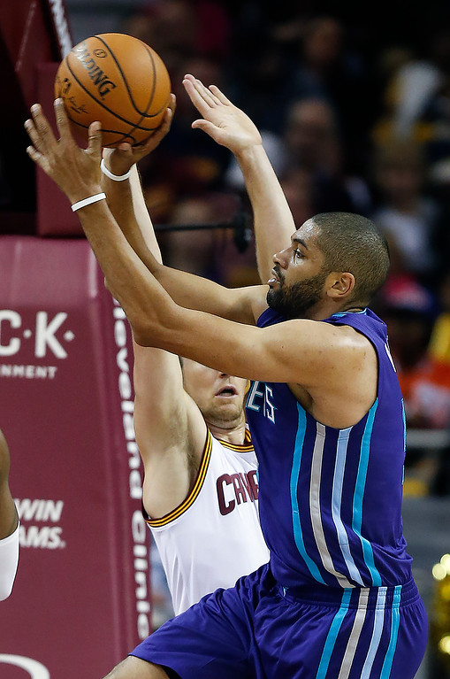 . Charlotte Hornets\' Nicolas Batum (5) passes against Cleveland Cavaliers\' Mike Dunleavy (3) during the first half of an NBA basketball game, Sunday, Nov. 13, 2016, in Cleveland. (AP Photo/Ron Schwane)