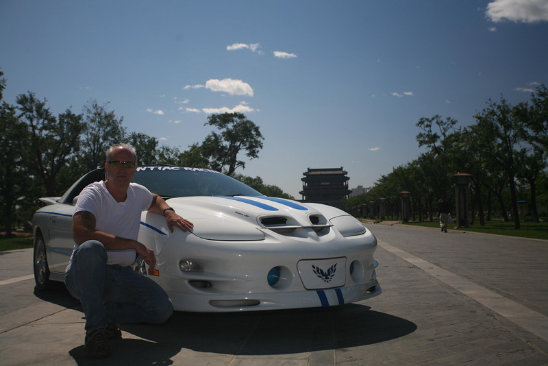 Me and my Trans Am in Beijing Summer 2008 Photo. I imported it from Boston in 2004 © Lewis Sandler BeijingVideoStudio