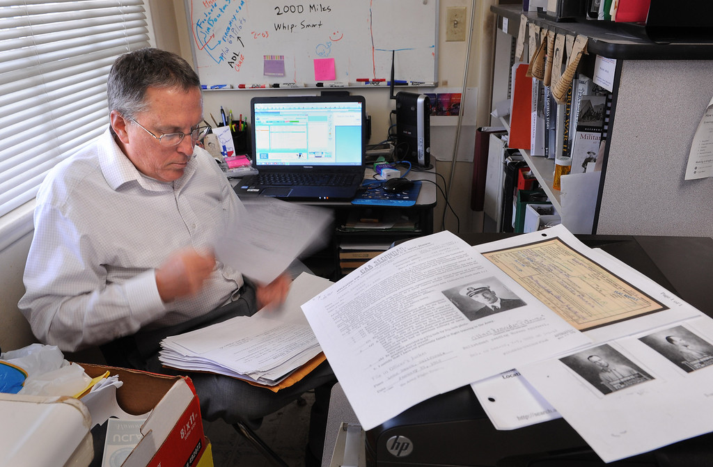 ". William ""Bill\"" Beigel of Torrance sits in his kitchen office space where he has been doing historical military research into the WWll deaths of UCLA alumni. Photo by Brad Graverson 3-26-13"