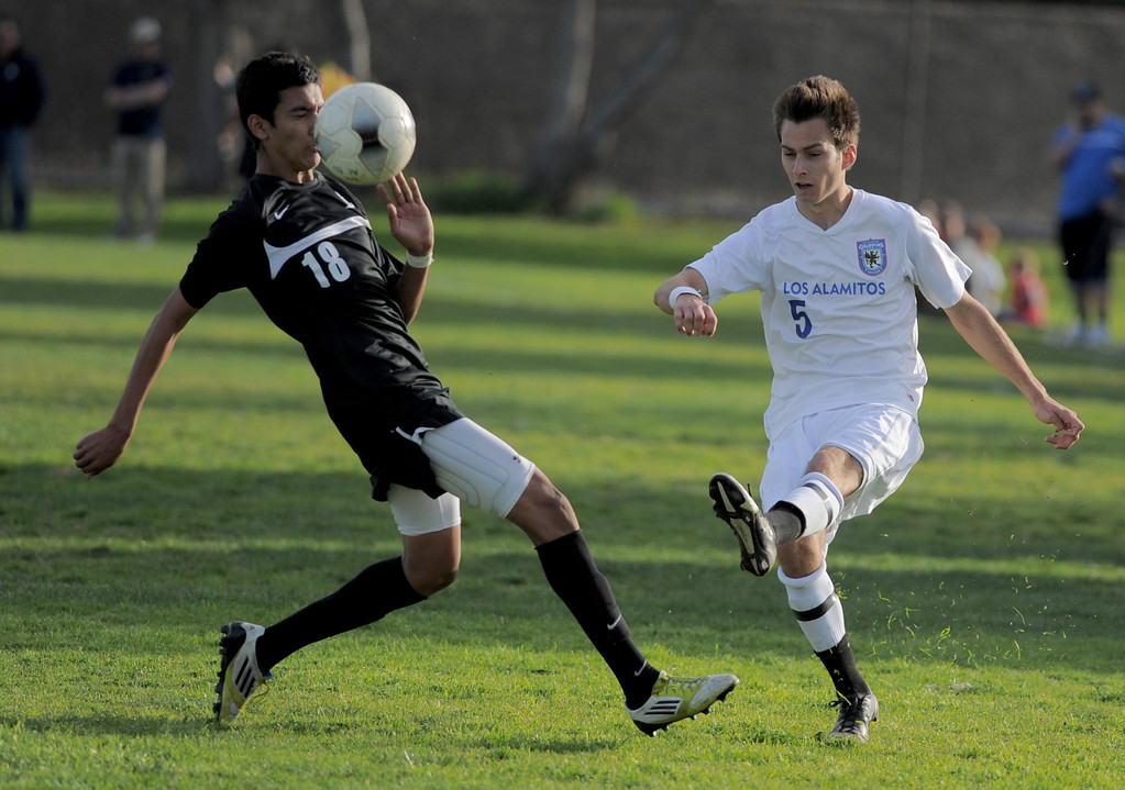 . 02-15-2012--(LANG Staff Photo by Sean Hiller)- Los Alamitos beat Buena 4-1 in the first round of the Division 1 boys soccer playoffs Friday at Laurel School in Los Alamitos. Zach Way battles Buena\'s Lalo Cabrera (18).