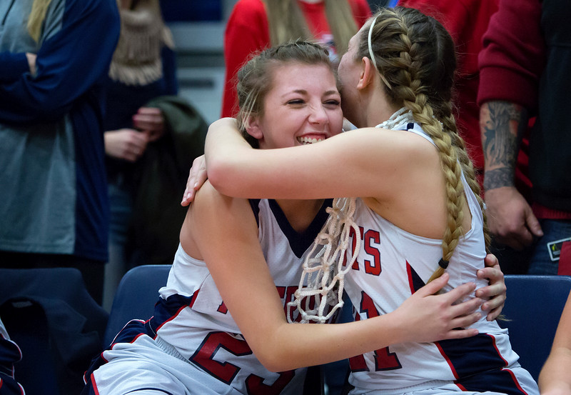 AUGUSTA, Maine -- 03/03/2017 -- Gray-New Gloucester's Haley Kirby (left) celebrates with Gray-New Gloucester's Grace Kariotis after defeating Houlton during their Class B girls basketball state championship at the Augusta Civic Center in Augusta Friday. Ashley L. Conti | BDN
