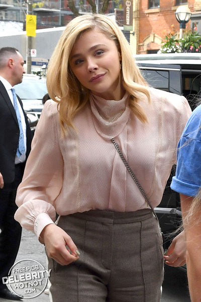 Chloe Grace Moretz In Pink Blouse With High-Waisted Trousers, Canada