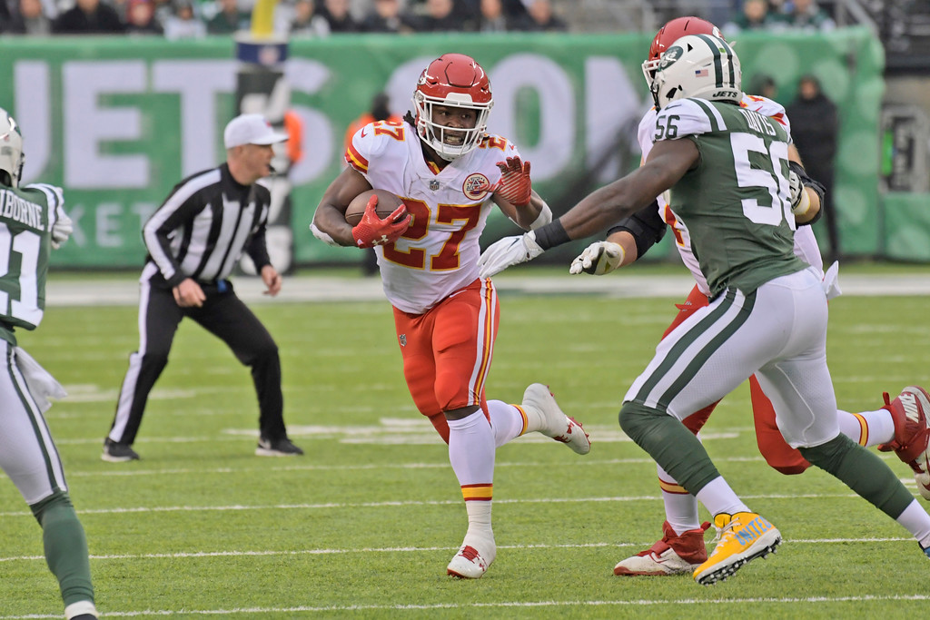 . Kansas City Chiefs\' Kareem Hunt runs the ball during the first half of an NFL football game against the New York Jets, Sunday, Dec. 3, 2017, in East Rutherford, N.J. (AP Photo/Bill Kostroun)