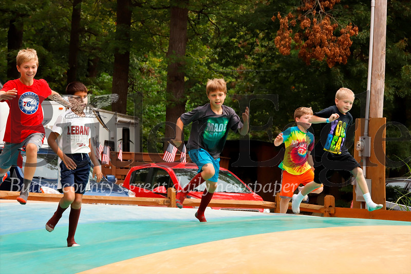 Kids race across the Jump Zone bouncy floor at Yogi Bear's Jellystone Park at Kozy Rest in Harrisville Saturday. Seb Foltz/Butler Eagle 083119