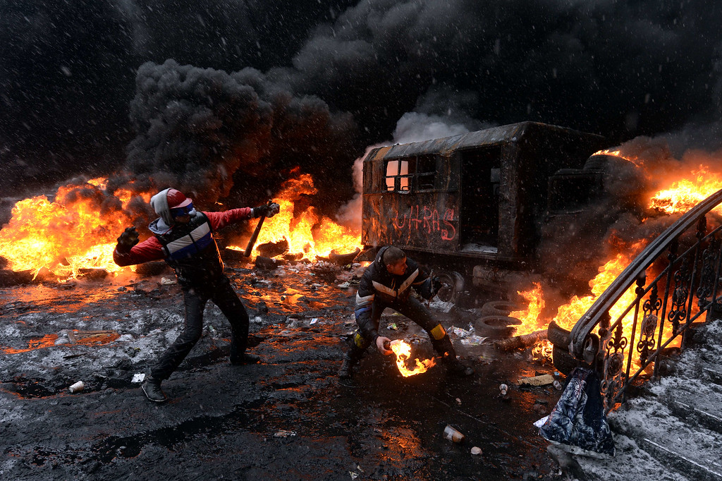 . A protestor throws a molotov cocktail at riot police in the centre of Kiev on January 22, 2014. AFP PHOTO/ VASILY MAXIMOV/AFP/Getty Images