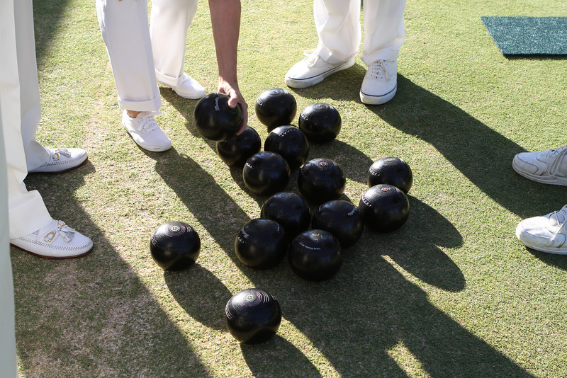 Four players in a game, four bowls per player, 16 heavy stones in a game.