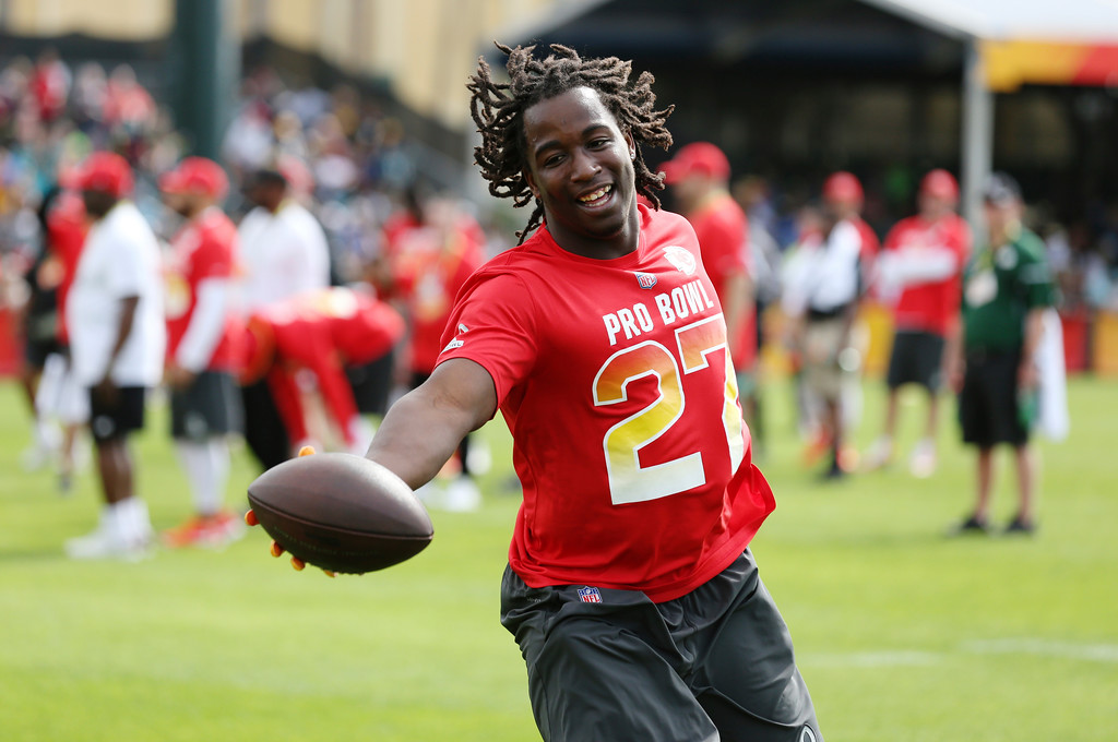 . AFC running back Kareem Hunt, of the Kansas City Chiefs, runs the ball in for a touchdown during Pro Bowl NFL football practice, Saturday, Jan. 27, 2018, in Kissimmee, Fla. (AP Photo/Steve Luciano)