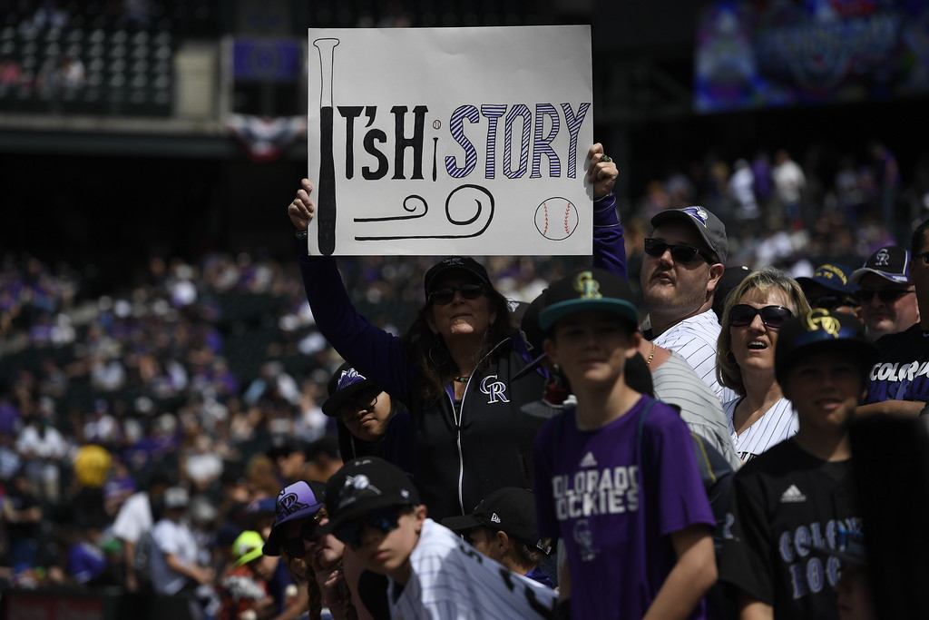. Fans hold a sign for rookie Trevor Story (27) of the Colorado Rockies as players take the field. The Colorado Rockies played the San Diego Padres Friday, April 8, 2016 on opening day at Coors Field in Denver, Colorado. (Photo By Andy Cross/The Denver Post)