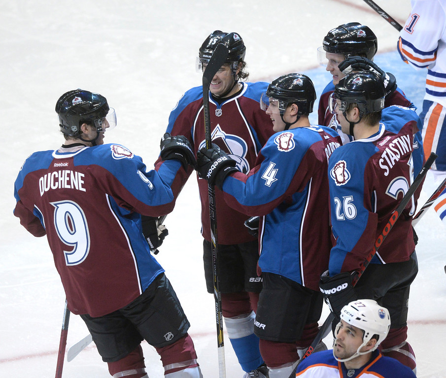 . DENVER, CO. - DECEMBER 19: Matt Duchene congratulated defenseman Tyson Barrie after he scored a goal in the second period. The Colorado Avalanche hosted the Edmonton Oilers in an NHL game at the Pepsi Center Thursday night, December 19, 2013.  Photo By Karl Gehring/The Denver Post