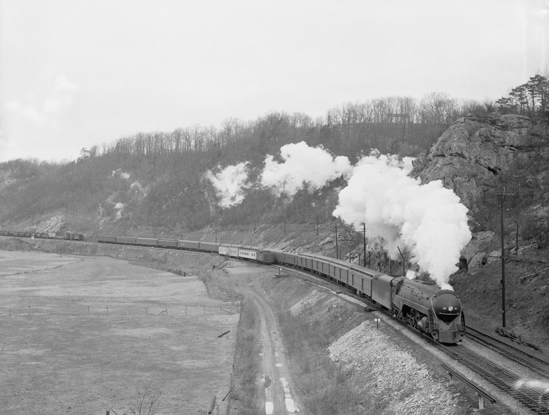 2018.15.N79.6189B--ed wilkommen 3x4 neg--N&W--steam locomotive 4-8-4 J 608 (streamlined) on passenger train action--location unknown--no date