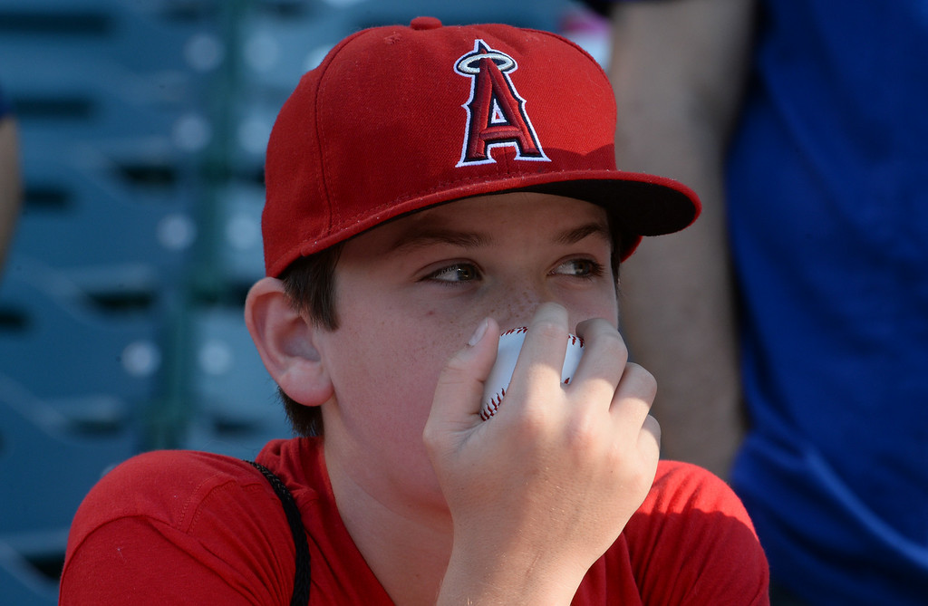 . A Los Angeles Angels fan waits for an autograph prior to a baseball game against the Los Angeles Dodgers at Anaheim Stadium in Anaheim, Calif., on Thursday, Aug. 7, 2014.  (Photo by Keith Birmingham/ Pasadena Star-News)