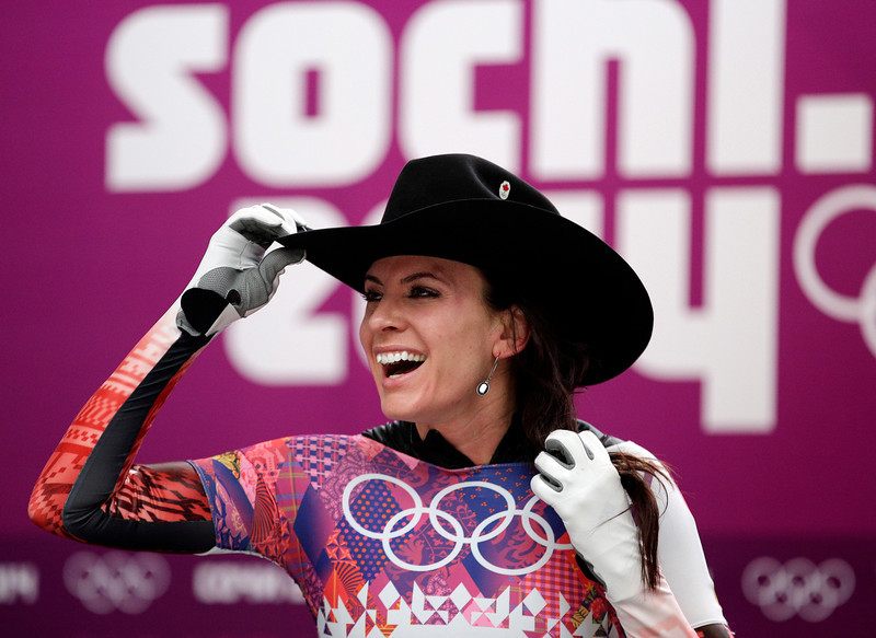 . Mellisa Hollingsworth of Canada puts on a cowboy hat after her final run during the women\'s skeleton competition at the 2014 Winter Olympics, Friday, Feb. 14, 2014, in Krasnaya Polyana, Russia. (AP Photo/Michael Sohn)
