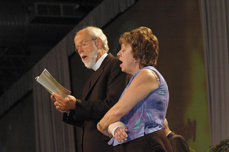 Presiding Bishop Mark Hanson and Faith Ashton, ELCA Church Council, Chapel Hill, North Carolina sing the closing hymn.