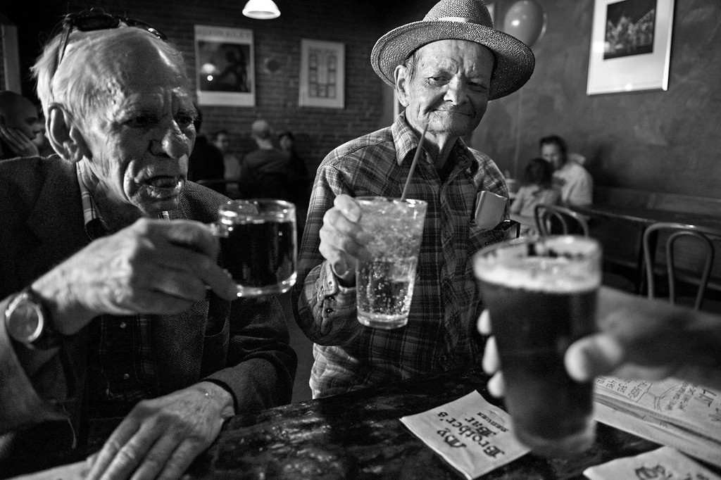 """. Cecil Bethea, left, and his partner, Carl Shepherd, toast with a friend to celebrate Carl\'s 72nd birthday at My Brother\'s Bar on March 22 in Denver, Colo. The couple agrees they met in a bar in 1969 but differ on the location. �There was a dispute we�ve never settled about where we met, I say it was in Mary�s Bar and Carl says it was the Backdoor. But we did meet,\"""" Cecil recalled. \""""He came up and asked me a silly� we got to talking and we spent the night together. We decided to see each other again� For lack of a better term you can say we dated for about 8 months.  We got to know each other and finally I think it was about Thanksgiving Carl suggested that we live together.� (Photo By Craig F. Walker/The Denver Post)"""