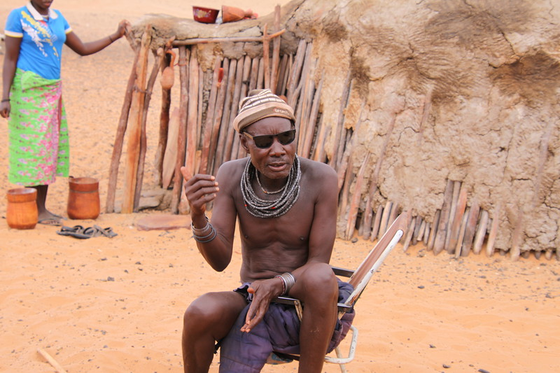 Chuck spoiled Himba culture forever by giving the Headman Prada sunglasses.
