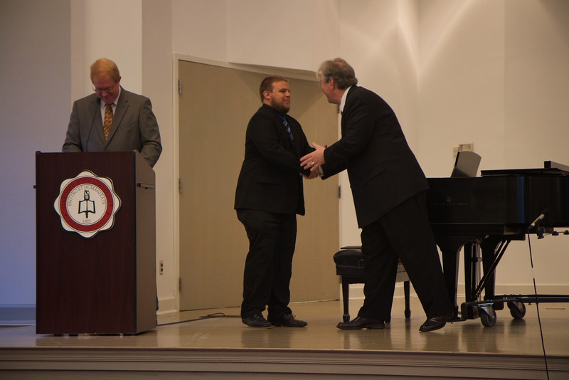 Passing of the Pi Kappa Lambda charter to initiate the Gardner-Webb Chapter of the national honors society for music, and induction ceremony. Tyler Scruggs