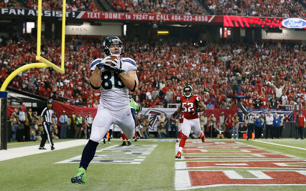 . Zach Miller #86 of the Seattle Seahawks catches a fourth quarter touchdown pass against the Atlanta Falcons during the NFC Divisional Playoff Game at Georgia Dome on January 13, 2013 in Atlanta, Georgia.  (Photo by Kevin C. Cox/Getty Images)