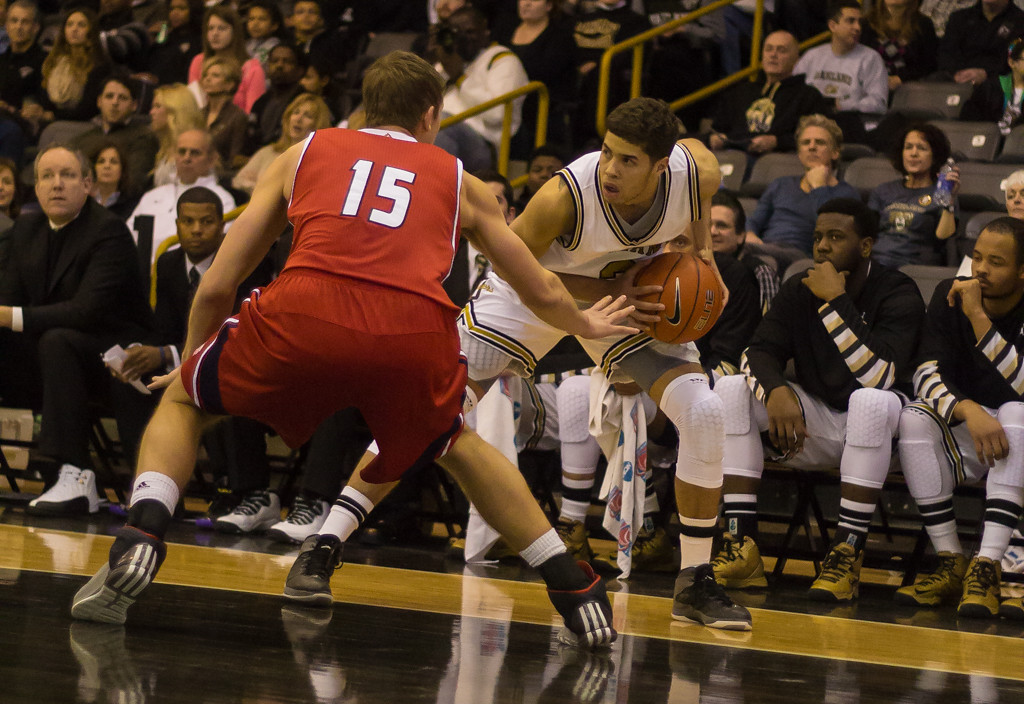 . Williams keeps the ball from the opposing UIC defender. Photos by Dylan Dulberg/The Oakland Press
