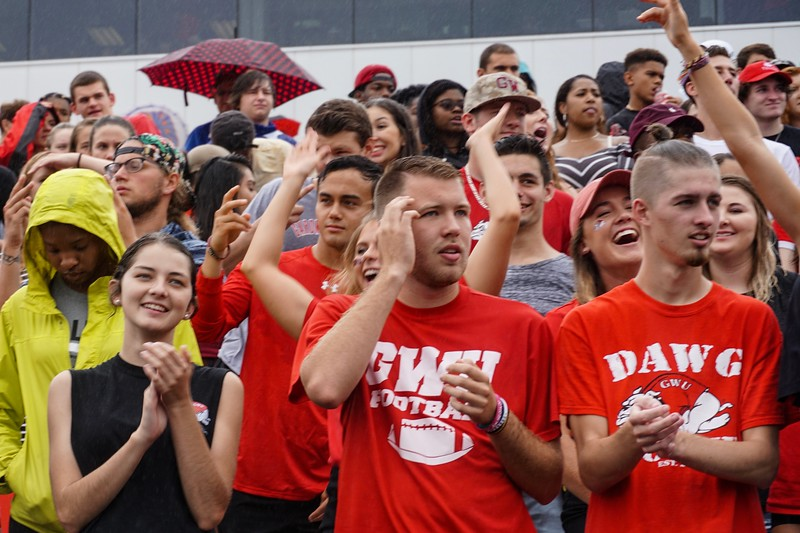 Even in cold and rainy weather, students are excited to watch the big game.