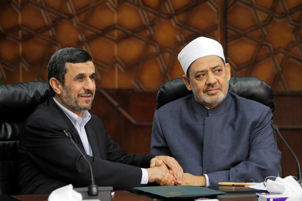 Description of . Iran's President Mahmoud Ahmadinejad, left, shakes hands with Grand Sheik Ahmed al-Tayeb, the head of Al-Azhar, the Sunni Muslim world's premier Islamic institution during their meeting at Al Azhar headquarters in Cairo, Egypt, Tuesday, Feb. 5, 2013. Once close, Egypt and Iran severed their relations after the 1979 Islamic Revolution when Cairo offered exile to Iran's deposed shah. Relations further deteriorated after Egypt's peace treaty with Israel. (AP Photo/Amr Nabil)