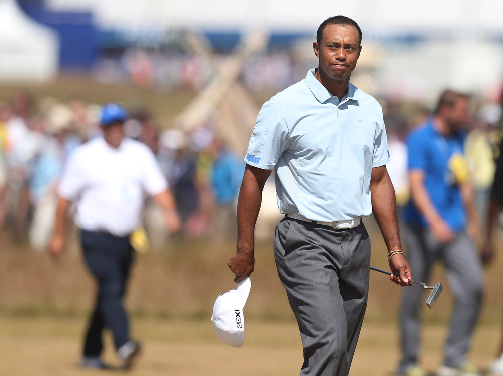 . Tiger Woods of the United States walks onto the 18th green during the second round of the British Open Golf Championship at Muirfield, Scotland, Friday July 19, 2013. (AP Photo/Scott Heppell)