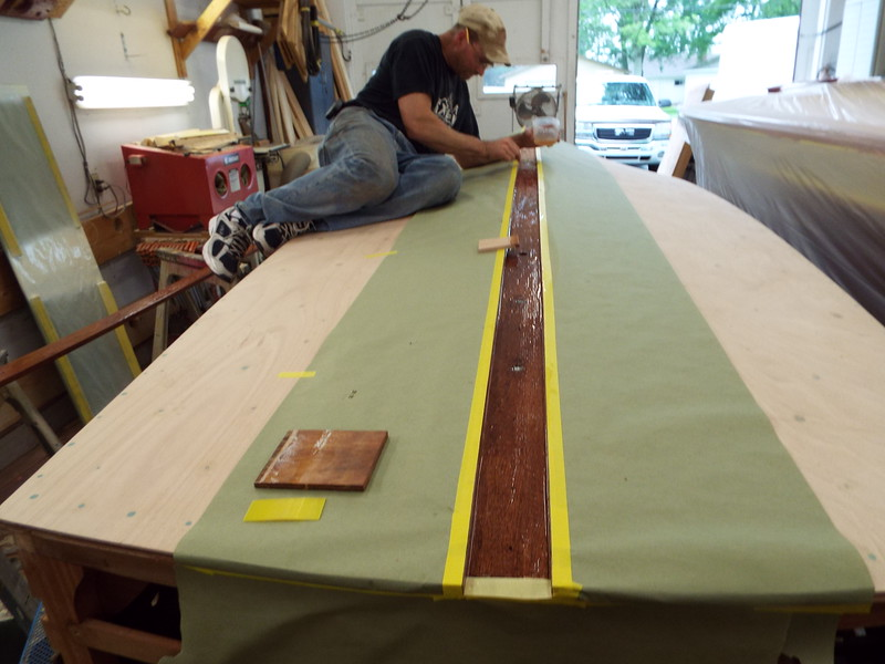 Applying epoxy to install the keel cap.