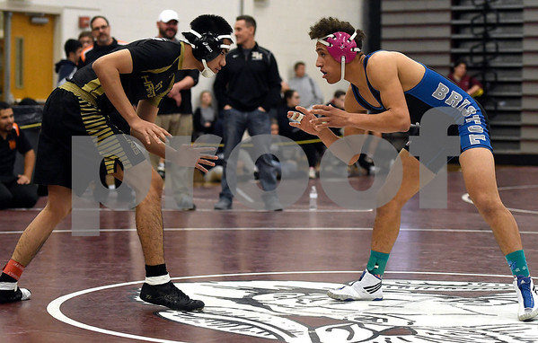 1/6/2018 Mike Orazzi | Staff Bristol Eastern's Diego Fernandez and East Hartford's Oscar Souvannavong in a 145 match during the Bristol Central High School Invitational wrestling match Saturday in Bristol.