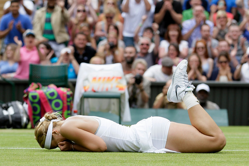 . Sabine Lisicki of Germany celebrates after beating Serena Williams of the United States in a Women\'s singles match at the All England Lawn Tennis Championships in Wimbledon, London, Monday, July 1, 2013. (AP Photo/Alastair Grant)