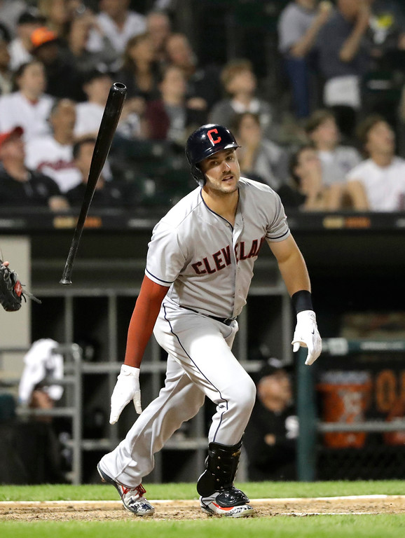 . Cleveland Indians\' Lonnie Chisenhall lets go of his bat after popping up during the seventh inning of a baseball game against the Chicago White Sox Tuesday, June 12, 2018, in Chicago. (AP Photo/Charles Rex Arbogast)