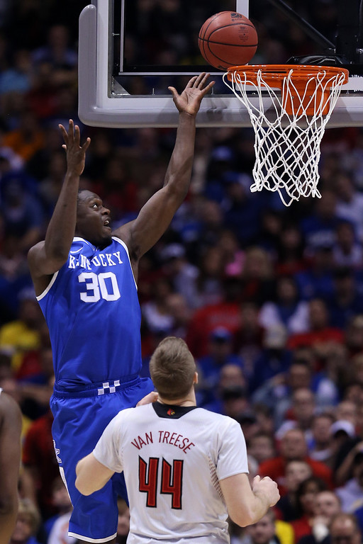 . Julius Randle #30 of the Kentucky Wildcats rebounds the ball against Stephan Van Treese #44 of the Louisville Cardinals during the regional semifinal of the 2014 NCAA Men\'s Basketball Tournament at Lucas Oil Stadium on March 28, 2014 in Indianapolis, Indiana.  (Photo by Jonathan Daniel/Getty Images)