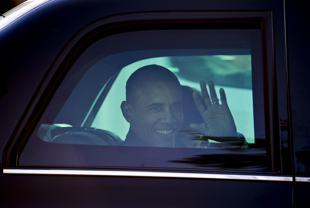 . US President Barack Obama waves as he leaves the premises of the Nelson Mandela foundation in Johannesburg on June 29, 2013. US President Barack Obama met the family of his critically ill hero Nelson Mandela on a visit to South Africa Saturday, the White House said. The president, whose landmark trip to Africa has been overshadowed by Mandela\'s illness, decided not to visit the ailing icon, instead meeting family members at the Mandela Centre of Memory in Johannesburg. ODD ANDERSEN/AFP/Getty Images