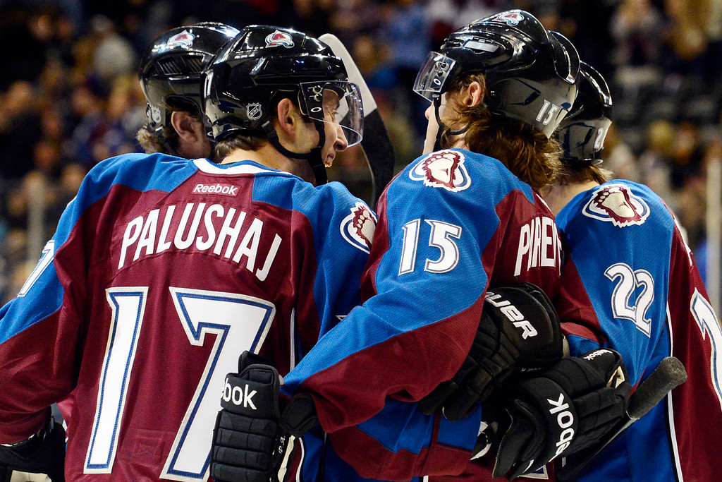. Aaron Palushaj (17) of the Colorado Avalanche celebrates his goal with teammates during the first period of action. The Colorado Avalanche take on the Nashville Predators at the Pepsi Center on February 18, 2013. (Photo By AAron Ontiveroz/The Denver Post)