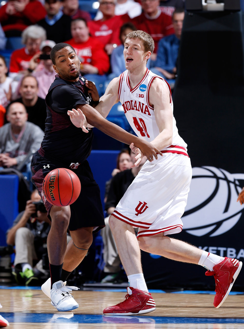 . Cody Zeller #40 of the Indiana Hoosiers and Khalif Wyatt #1 of the Temple Owls reach for a loose ball in the first half during the third round of the 2013 NCAA Men\'s Basketball Tournament at UD Arena on March 24, 2013 in Dayton, Ohio.  (Photo by Joe Robbins/Getty Images)